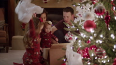 Medium shot of family opening Christmas presents / Cedar Hills, Utah, United Stock Footage