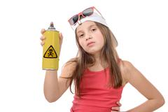 Young girl with a spray canwith poison Stock Photos