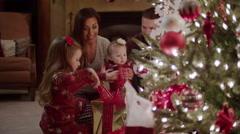Medium shot of family opening Christmas presents / Cedar Hills, Utah, United Stock Footage