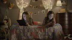 Medium shot of teenage girls using technology in bedroom / Cedar Hills, Utah, Stock Footage