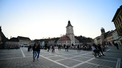 Tourists visiting old town of mediaval Brasov Stock Footage