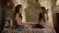 Medium shot of teenage girls talking at sleepover / Cedar Hills, Utah, United Stock Footage