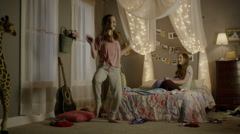 Medium panning shot of teenage girl dancing at sleepover / Cedar Hills, Utah, Stock Footage