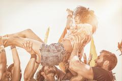 Happy hipster woman crowd surfing Stock Photos