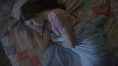 High angle close up of teenage girl sleeping during storm / Cedar Hills, Utah, Stock Footage