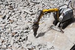 Pneumatic drill breaking concrete Stock Photos