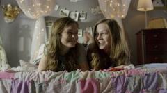 Medium shot of teenage girls smiling on bed / Cedar Hills, Utah, United States Stock Footage
