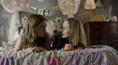 Medium shot of teenage girls laughing on bed / Cedar Hills, Utah, United States Stock Footage