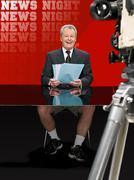 News presenter in shorts Kuvituskuvat