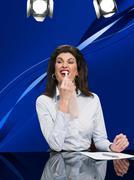 News presenter using tooth whitening pen Kuvituskuvat
