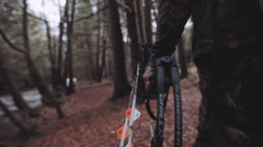 Bow hunter walking through the woods with bow and arrows. - stock footage