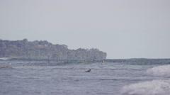 Wide shot of people swimming in ocean waves / Playa Hernadez, Punta Arenas, Stock Footage