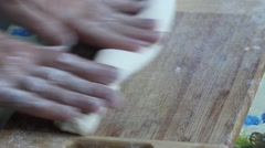 Chef kneading dough on cutting board Stock Footage