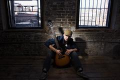 Portrait of a guitarist Stock Photos