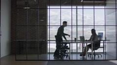 Wide panning shot of business people talking in meeting / Lehi, Utah, United Stock Footage