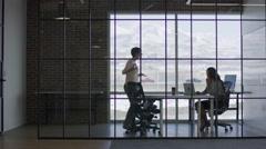 Wide panning shot of businesswomen talking in meeting / Lehi, Utah, United Stock Footage