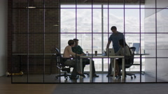 Wide panning shot of business people talking in meeting / Lehi, Utah, United Stock Footage