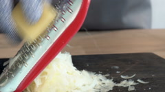 Parmesan cheese being grated - stock footage