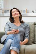 Mature woman listening to an mp3 player Stock Photos