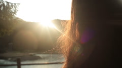 Close up of beautiful brunette young girl with sun in her hair. Young forest - stock footage