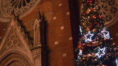 Beautiful Christmas tree front of a Catholic church, background Stock Footage