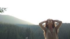 Sensual happy brunette girl in white traditional ukrainian summer dress standing Stock Footage