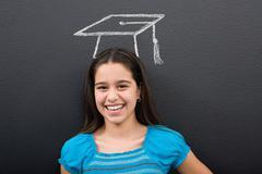 A girl with a chalk mortar board Stock Photos