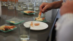 eating canapes of shrimp from the table - stock footage