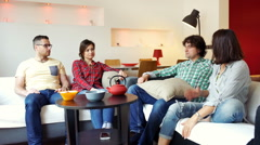 Friends quarrelling in the flat and man tries to accommodate them Stock Footage