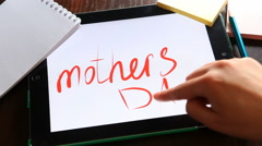 Happy mothers day. Hands writing words on tablet. Stock Footage