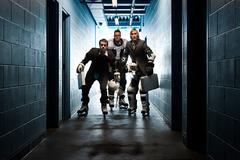 Three businessmen wearing ice hockey uniforms Stock Photos