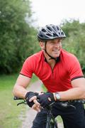 Mature man on a mountain bike Stock Photos