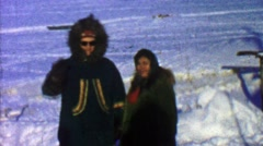 1957: Native embroidered winter cold weather fur coats in snowscape. Stock Footage