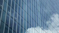 Moving clouds reflect onto office windows Stock Footage