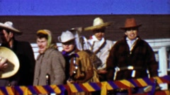1957: High school band members sombreros Mexican theme parade. - stock footage