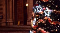 Sparkling lights on Christmas tree in garden of Catholic church, background Stock Footage