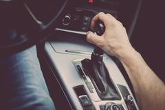 Hand on gear stick - stock photo