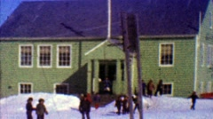 1957: One room schoolhouse kids play outside winter cold sunny day. - stock footage