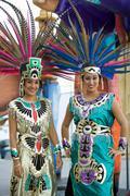 Women in aztec costumes - stock photo