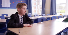 4K Naughty child kept after school for detention is given work to do by teacher Stock Footage