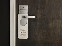 Do not disturb sign on a hotel room door - stock photo