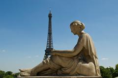 Statue and eiffel tower Stock Photos