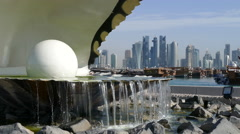 Close up from the Pearl Monument and fountain located along the Dhow Harbour Stock Footage