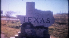 3306 Texas stateline boundary marker side of highway - vintage film home movie Stock Footage