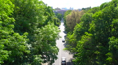 Cars Driving on the Road Among Trees - stock footage