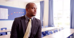 4k,Portrait of a happy and proud African American high school teacher - stock footage