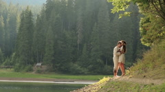 Gorgeous mermaid in flowers wreath from the lake in the woods in love with man - stock footage