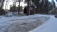 Young Girl Carries Firewood Out Of The Old Barn In Winter Forest, medium shoot Stock Footage
