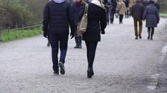 Crowd of people enjoying walk in park, spring nature awakening, active lifestyle Stock Footage