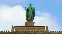 Lady Justice statue atop Upper Bavarian governmental building in Munich, Germany Stock Footage